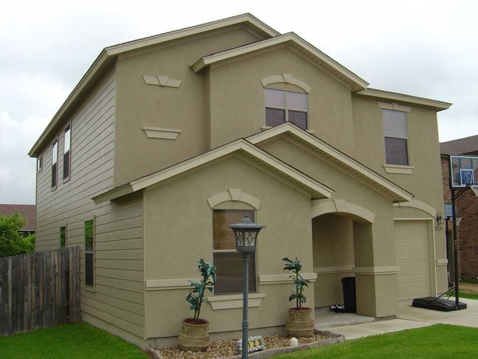 Отделка фасадов частных домов — 42 фото.